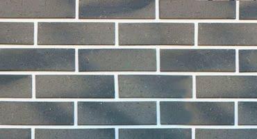 услуги отделки фасада плиткой